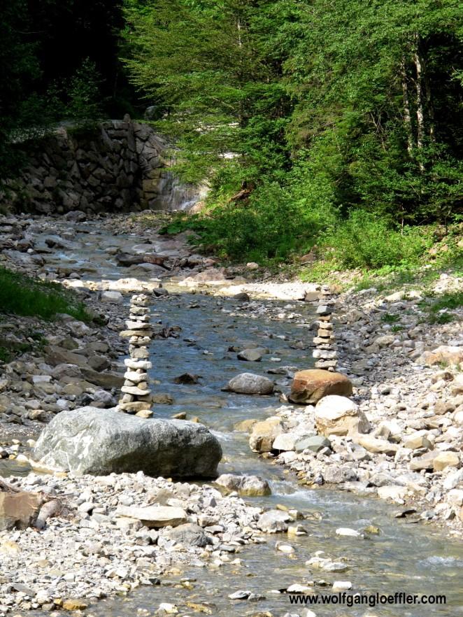 stone men on a creek